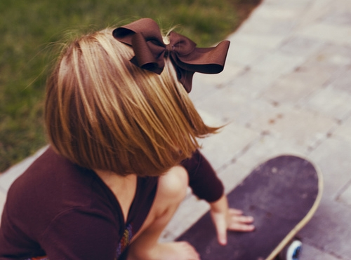 little-girl-on-skateboard-with-bow-in-hair