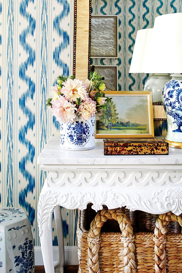 Bartholomew mixes a great deal of pattern and ornament: a batik-inspired wallpaper (Pierre Frey's Toiles de Nantes), leopard-print runner, and chinoiserie porcelain. The space feels lively rather than overwhelming due to her careful attention to scale and the refined color palette. Sarah Bartholomew Traditional Colorful Decor.