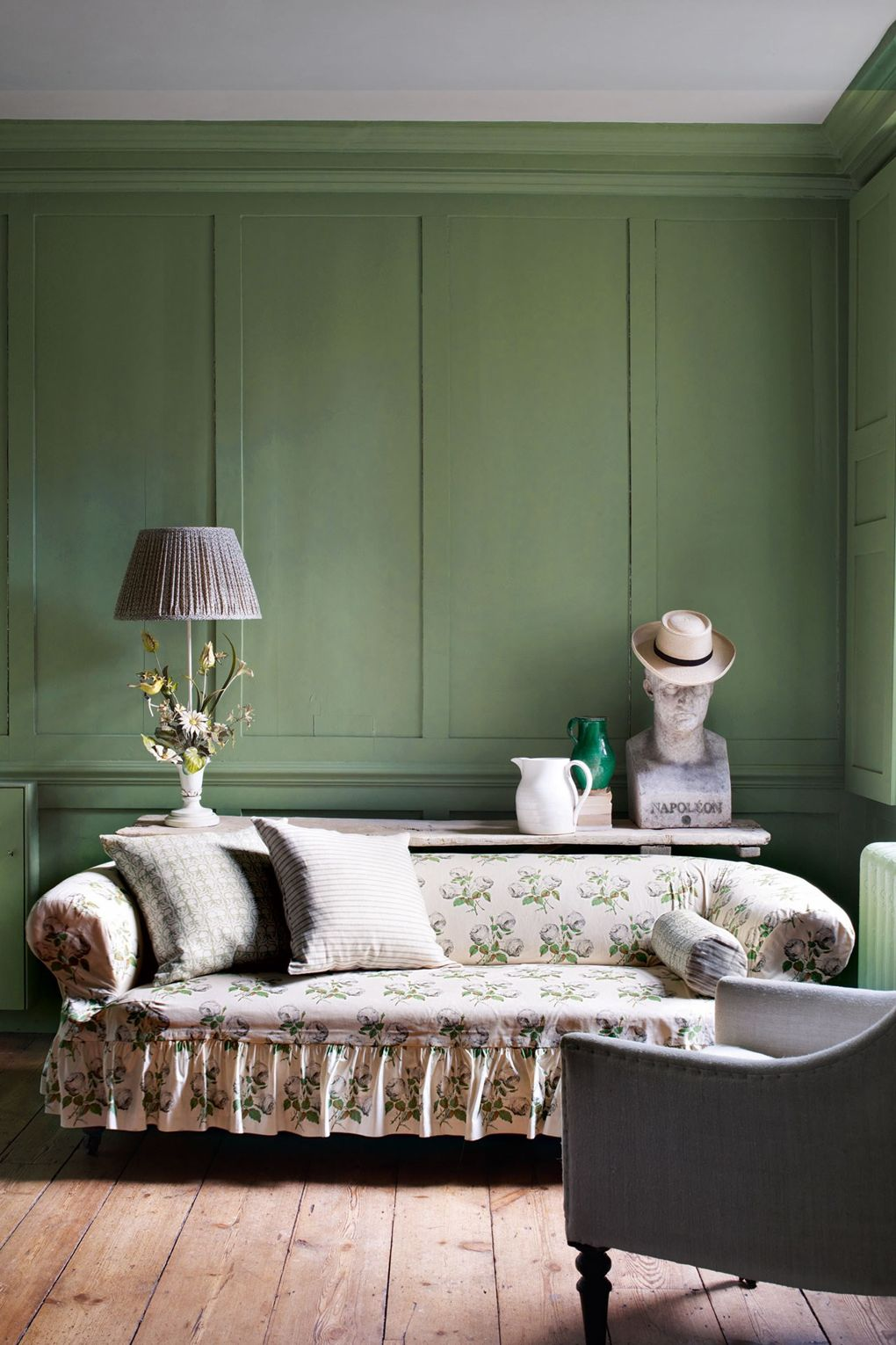 Farrow and Ball Breakfast Room Green Walls Slipcovered Sofa Ruffled Skirt Colefax and Folwer Bowood Print