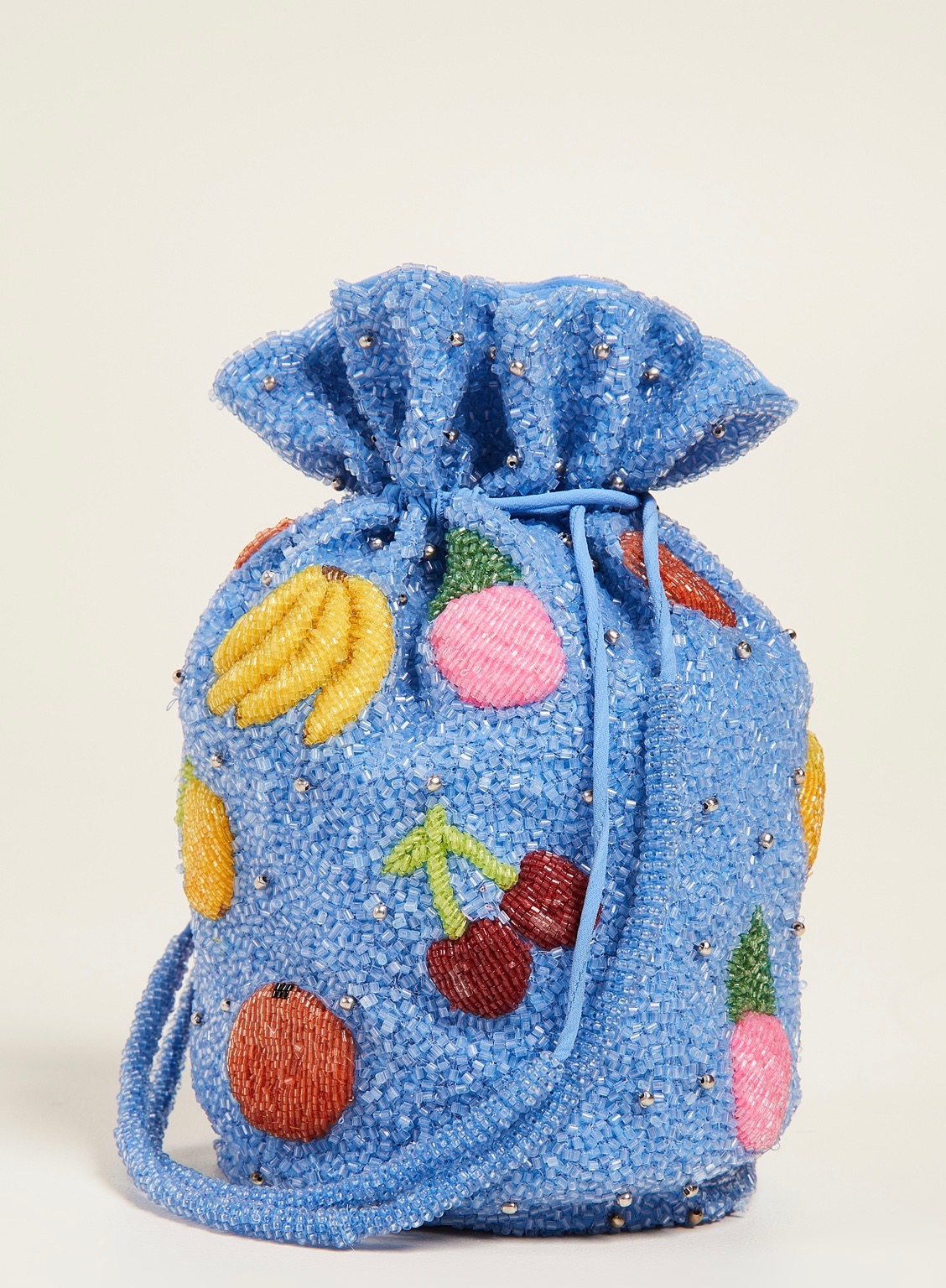 Blue beaded fruit bucket bag by Ganni