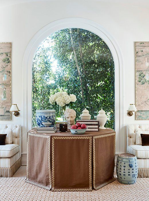 Mark D Sikes Los Angeles Home Brown Skirted Table Blue White Ginger Jar Banquettes Tassel Trim