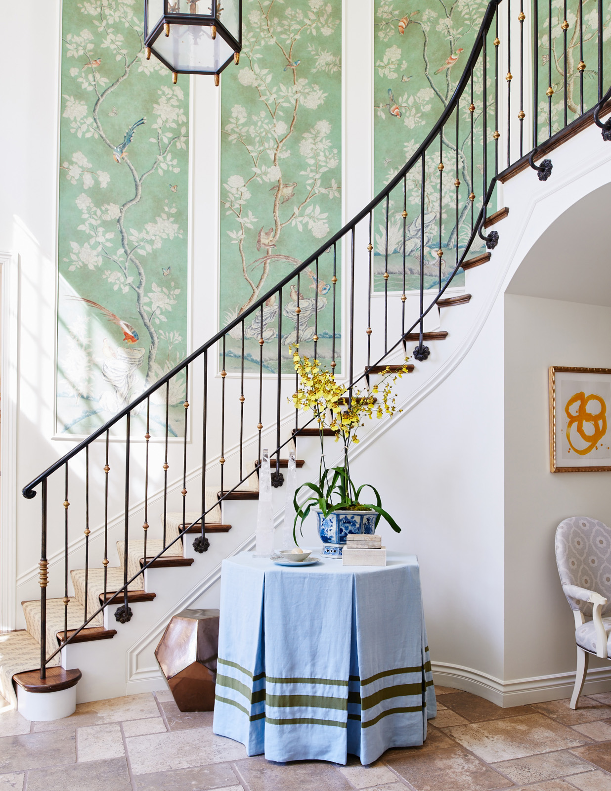 Mark D Sikes Foyer Skirted Table Pleated Octagonal Chinoiserie Wallpaper Panels Iron Staircase
