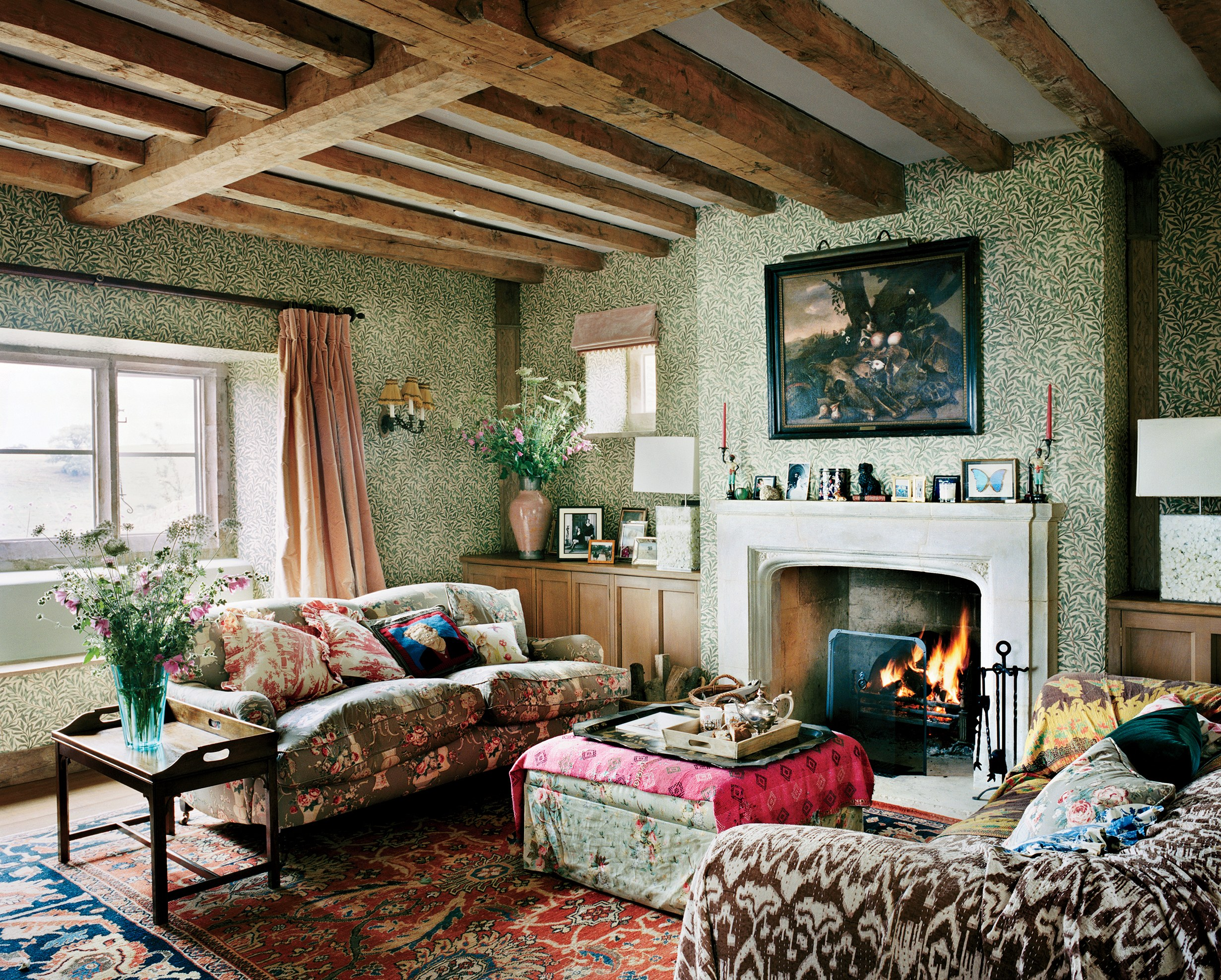 Plum Sykes English Country House William Morris Wallpaper Willow Boughs Chintz Roll Arm Sofa Fireplace Mantle Exposed Beams