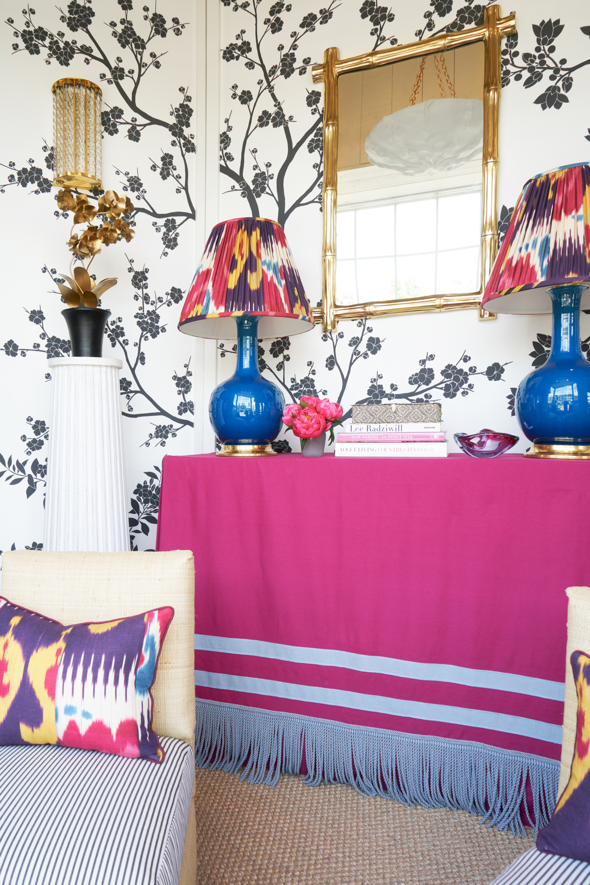 Paloma Contreras Pink Skirted Console Table Tassel Trim Ikat Lampshades Blue Table Lamps