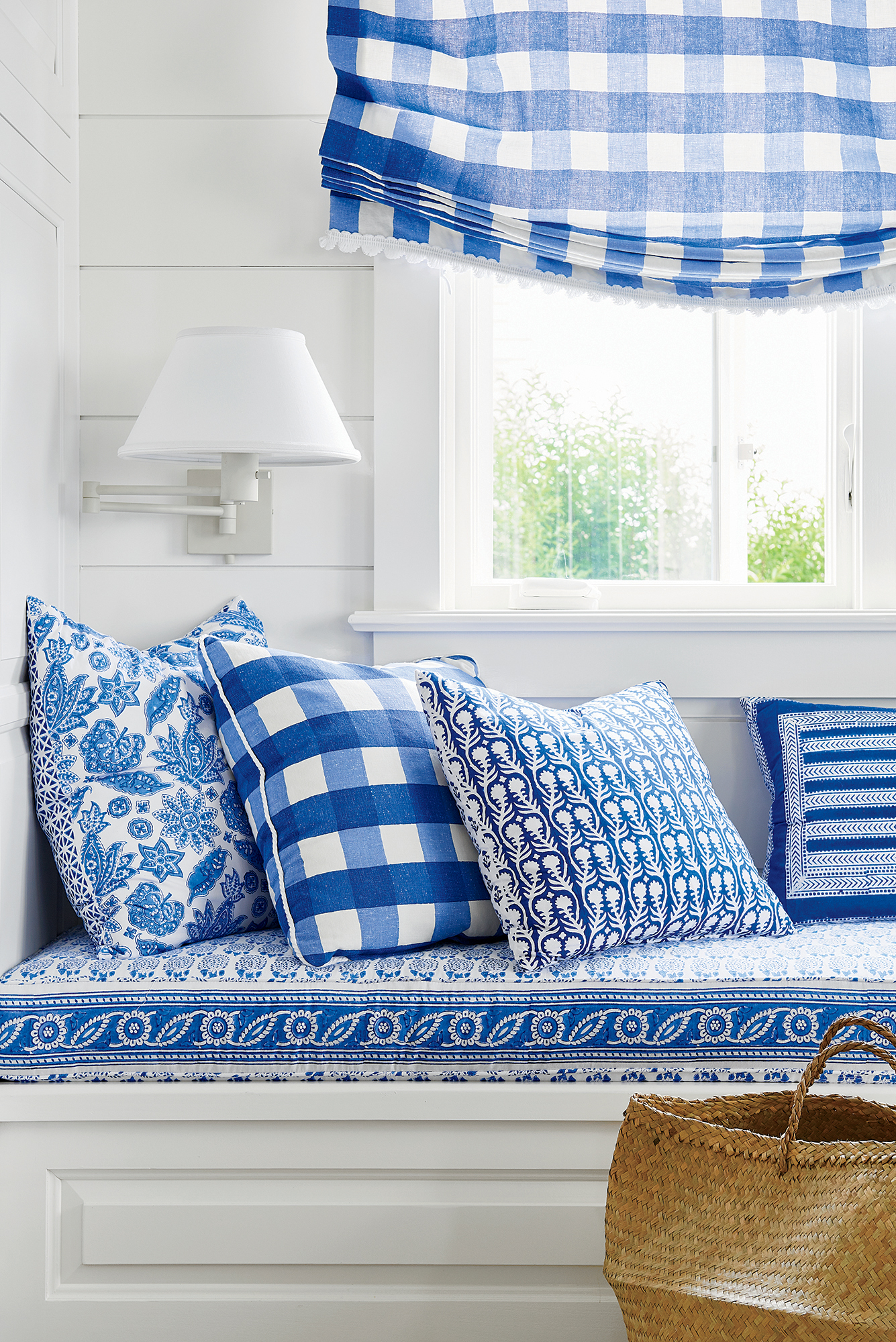 Blue and White Pillows on a Window Seat Designed by Mark D. Sikes