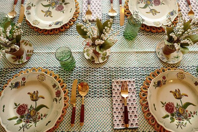 Block print tablecloth and floral dinner plates on a table setting in Amanda Brooks' new Cotswolds boutique, Cutter Brooks, in Stow-on-the-Wold, England