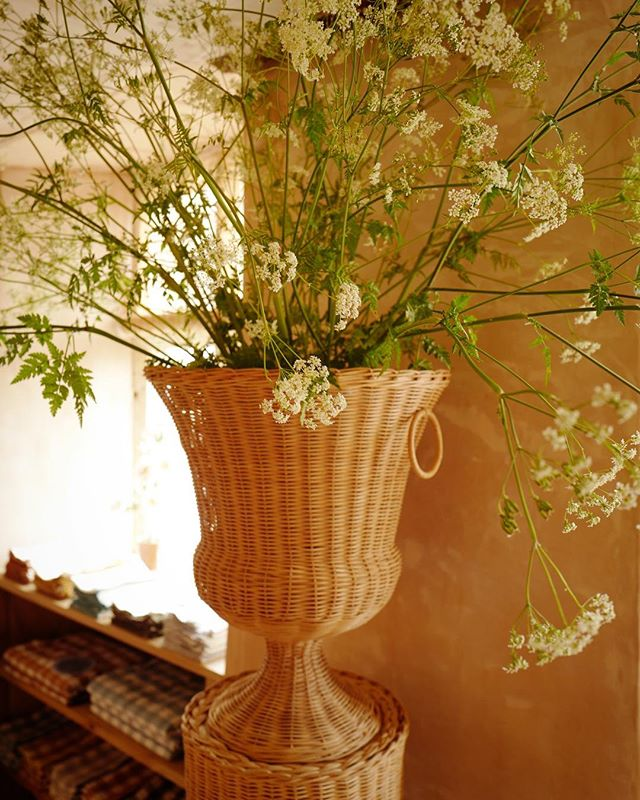 Amanda Brooks' new Cotswolds boutique, Cutter Brooks, in Stow-on-the-Wold, England. Wicker pedestal and urn by Atelier Vime.