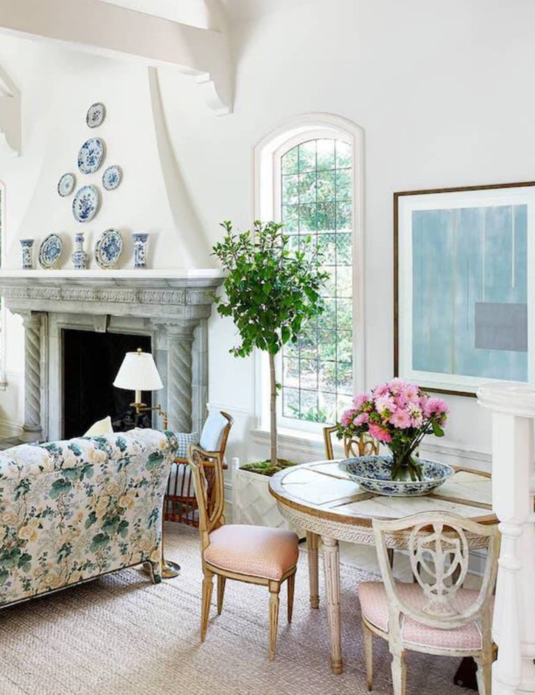 Mark D Sikes Montecito Vacation Home Living Room Floral Lee Jofa Chintz Sofa Blue White Plates Hung Walls Indoor Tree Sisal Rug Katie Considers