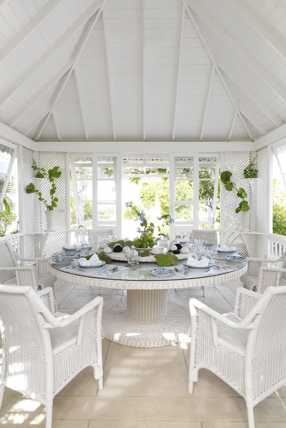 White wicker by Soane in a Mustique villa dining room decorated by Veere Grenney