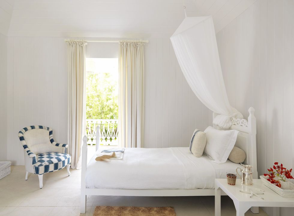 White tropical bedroom in a Mustique villa decorated by Veere Grenney
