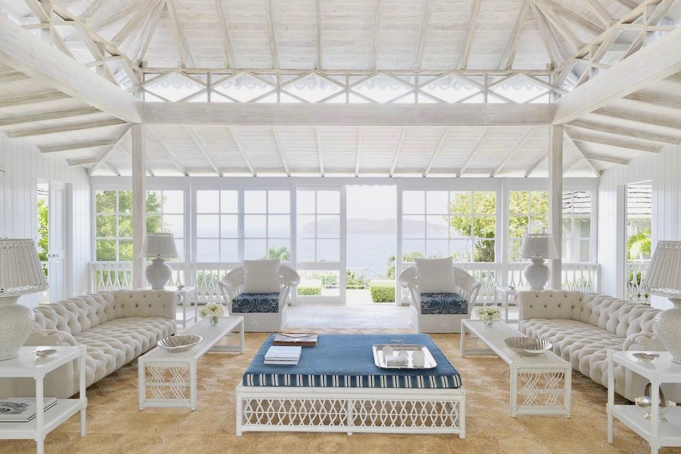 White wicker furniture by Soane in a Mustique villa living room decorated by Veere Grenney