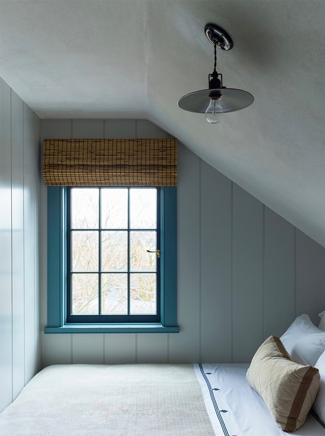 Sleeping Nook in a Sag Harbor Bedroom by Steven Gambrel with Bamboo Shades