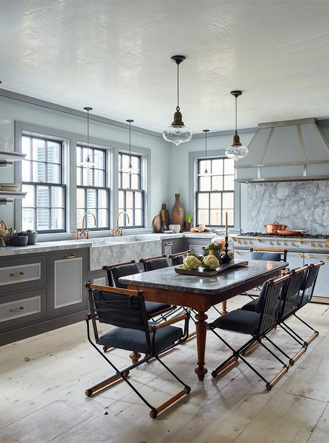 Sag Harbor kitchen designed by Steven Gambrel with wide plank pine floors and a dining table.