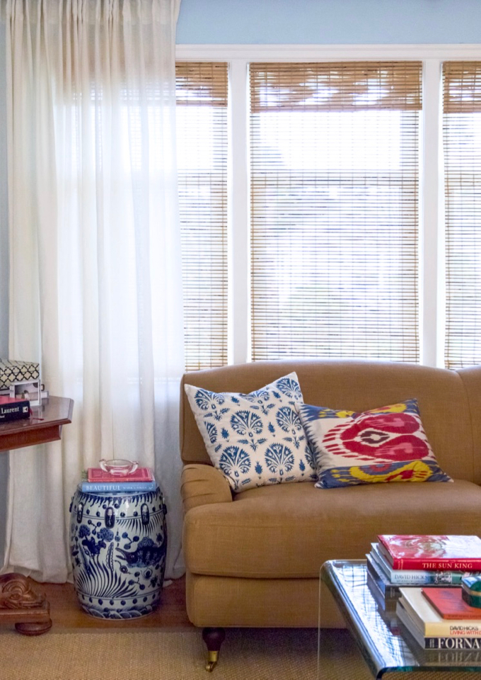 Interior Define Rose Sofa in Katie Armour Taylor's Seattle Living Room with Ikat Pillows and Blue and White Garden Stool