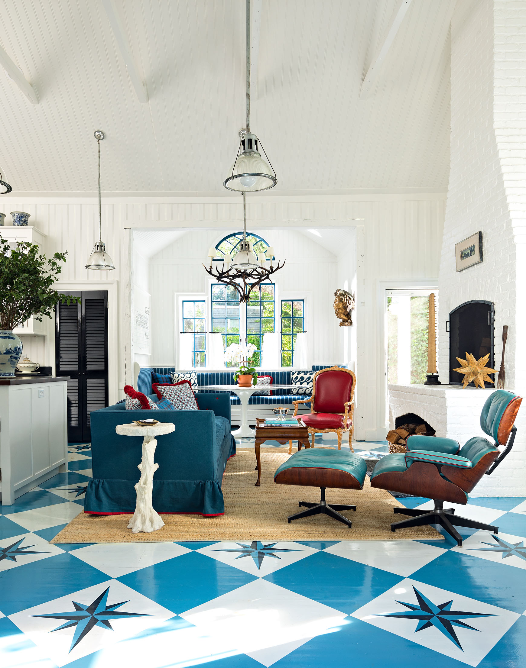 Blue and white painted checkerboard floors with compass stars in a Sag Harbor home decorated by Nick Olsen