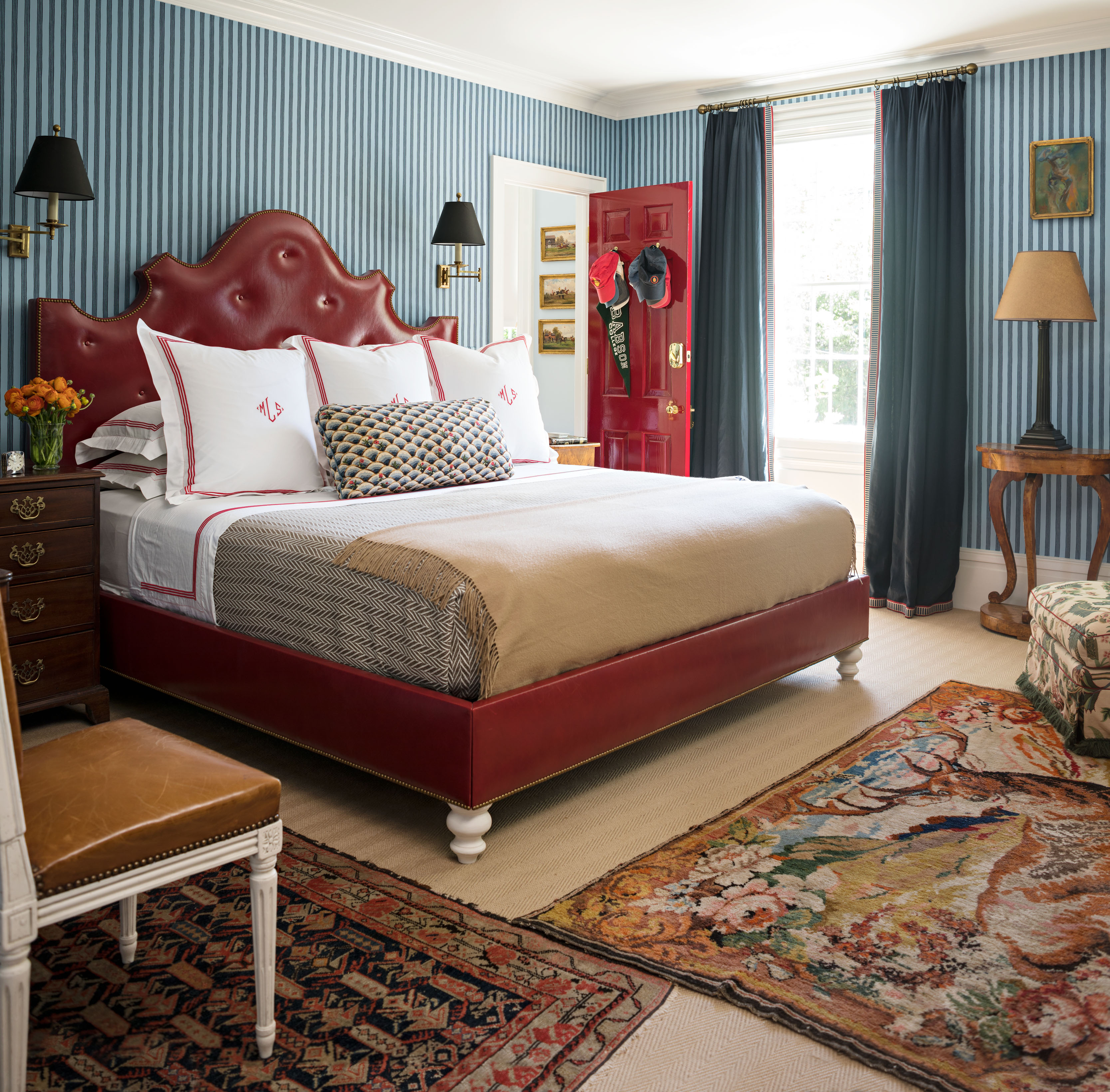 Nick Olsen Sag Harbor Home Master Bedroom Blue Striped Walls Red Tufted Leather Headboard Michael Lorber Katie Considers
