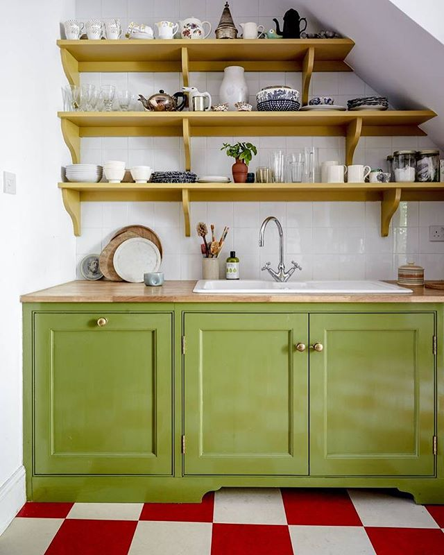 Bridie Hall London Townhouse Kitchen Open Shelving Green Cabinetry Red and White Checkerboard Linoleum Floors Butcher Block Countertops