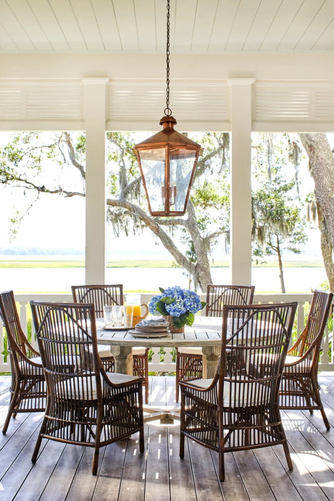 Round Outdoor Dining Table Porch Hydrangea Bouquet in Vase Copper Lantern Bamboo Chairs Heather Chadduck Interiors Southern Living Idea House 2019