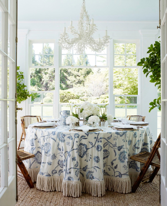 Aerin Lauder East Hampton Sunroom Dining Table Bamboo Chairs Skirted Table with Tassel Trim