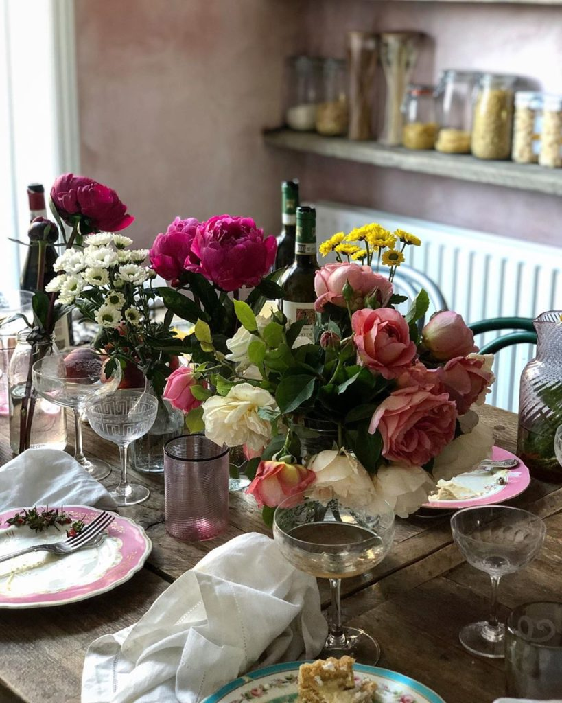 Skye McAlpine Home Cook Venice Italy Dining Room Kitchen Table Roses Champagne