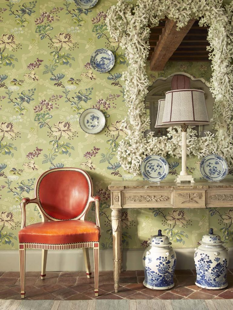 Cathy Kincaid The Well Adorned Home Dining Room with Green Wallpaper and Red Leather Chair and Blue and White Porcelain