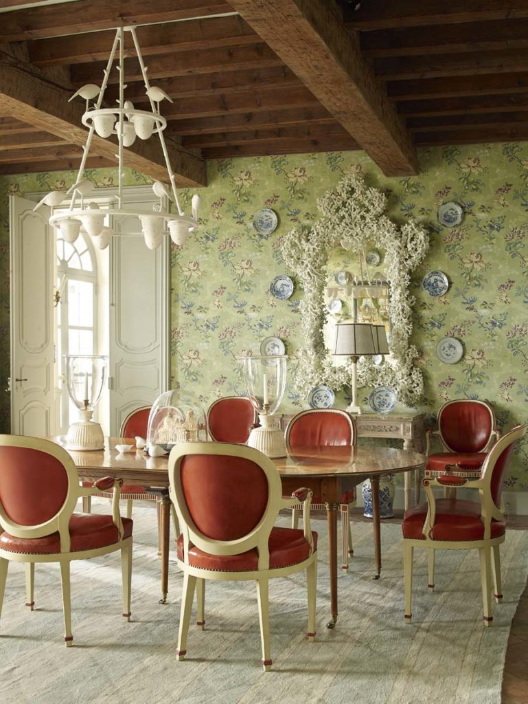 Cathy Kincaid The Well Adorned Home Dining Room with Green Wallpaper and Red Leather Chairs and Exposed Ceiling Beams
