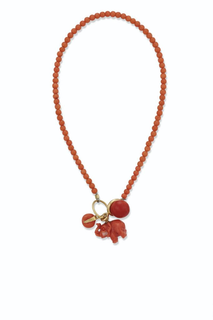 Coral and Gold Charm Bracelet from the Lee Radziwill Auction at Christie's