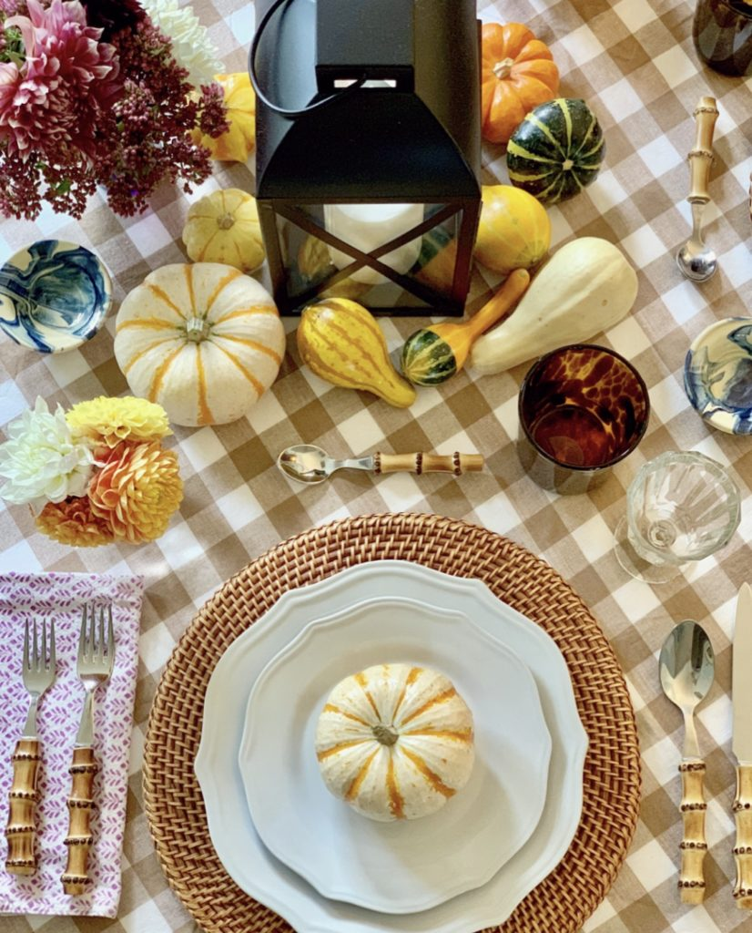 Fall Table Setting with Plaid Tablecloth and Rattan Chargers, Pumpkins, Gourds, Lantern Centerpiece