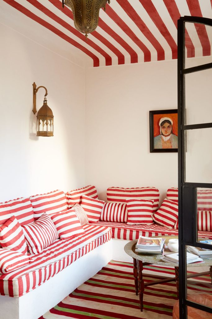 Red and white stripe sofa of La Di Dar decorated by Gavin Houghton in Tangier, Morocco.