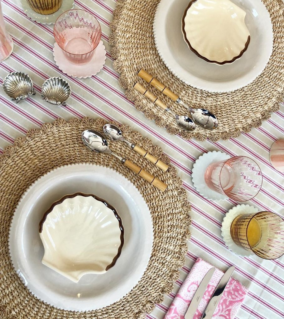 Pink stripe tablecloth with seashell dishes