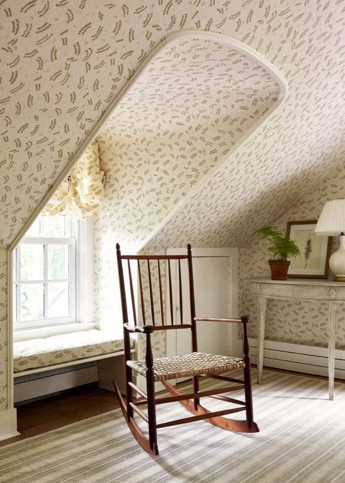Attic room with wallpaper and window seat by McGrath II.