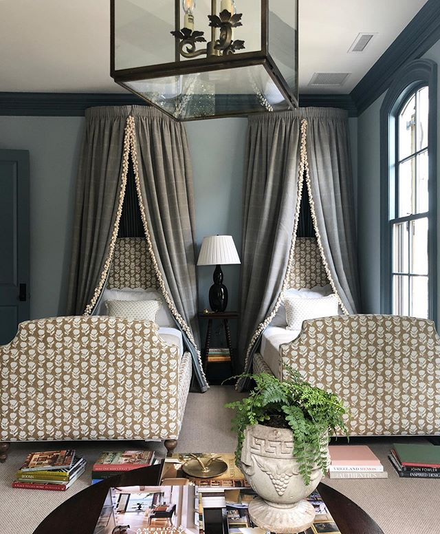 Bedroom with twin bed and windowpane canopies with lantern