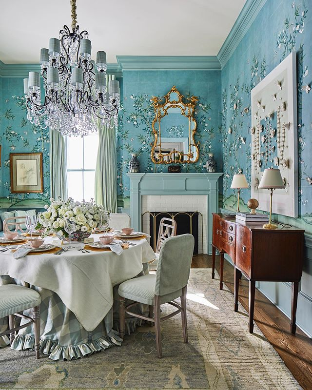 Dining rom by Becky Boyle with blue chinoiserie wallpaper by Gracie Studio. Love the floral wallcovering and gingham ruffled skirted round table.