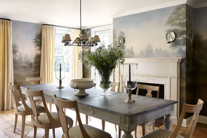 Dining room with landscape mural and Swedish gingham dining chairs decorated by McGrath II.