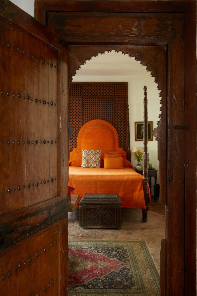 Orange headboard in a bedroom in Dar Zero - Inside Tangier book