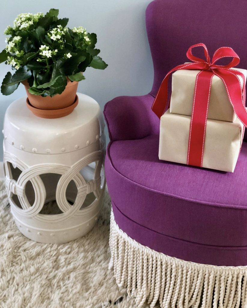 White Ceramic Garden Stool and Purple Tassel Trim Chair