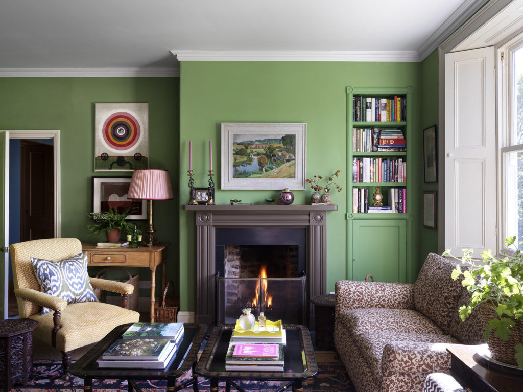 Green walls in living room at Rita Konig's North Farm in England.