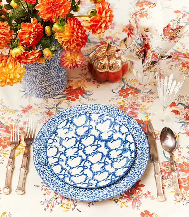 Thanksgiving table setting by Tory Burch with blue and white plates