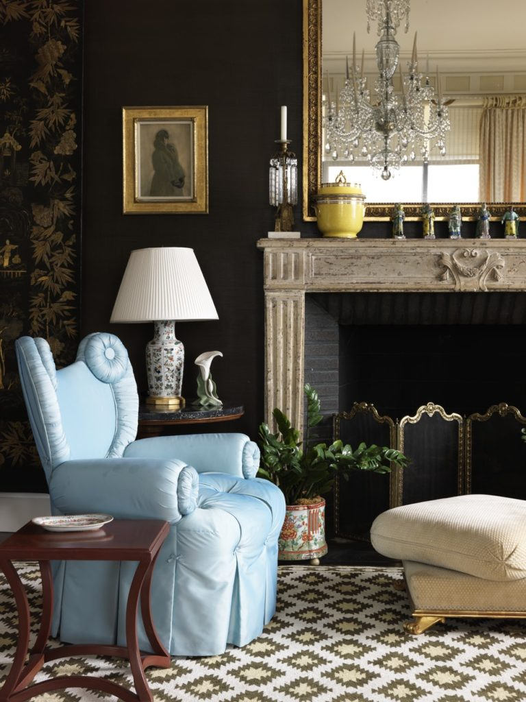 Chocolate brown living room walls and blue silk chair by Libby Cameron.