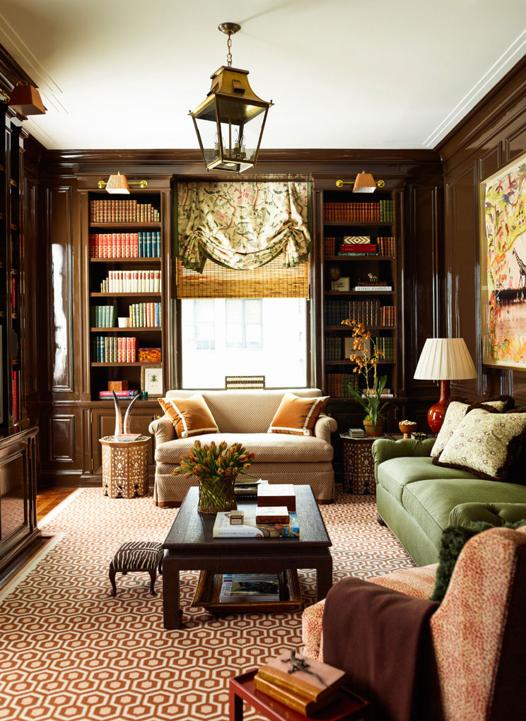 Lacquered brown walls in a library by Ashley Whittaker Design