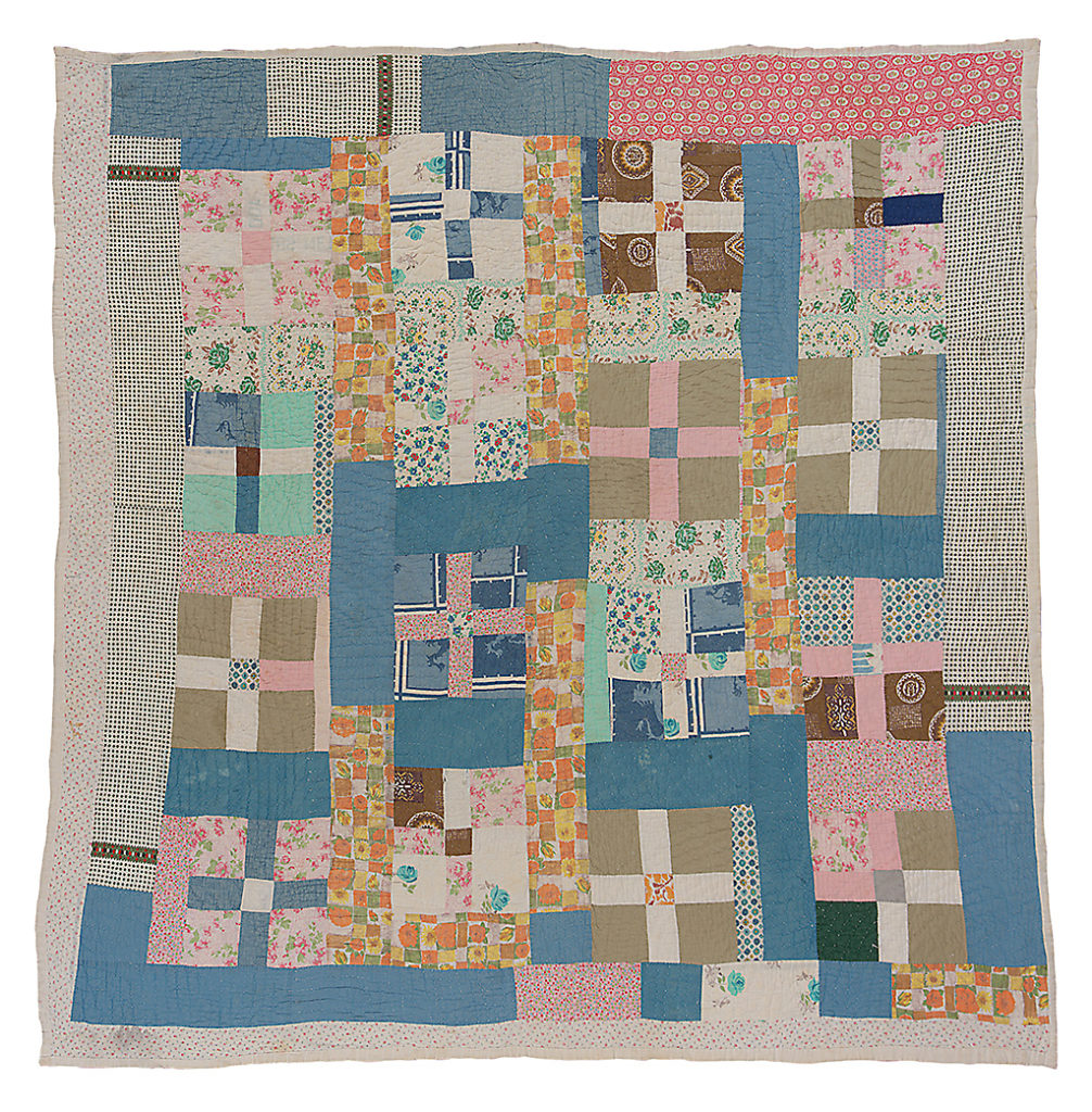 Hand-stitched quilt from Gee's Bend, Alabama. Cross in block.