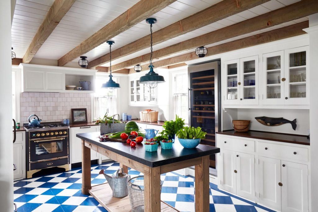 Martha's Vineyard cottage decorated by Victoria Hagan. Kitchen with checkerboard floors.