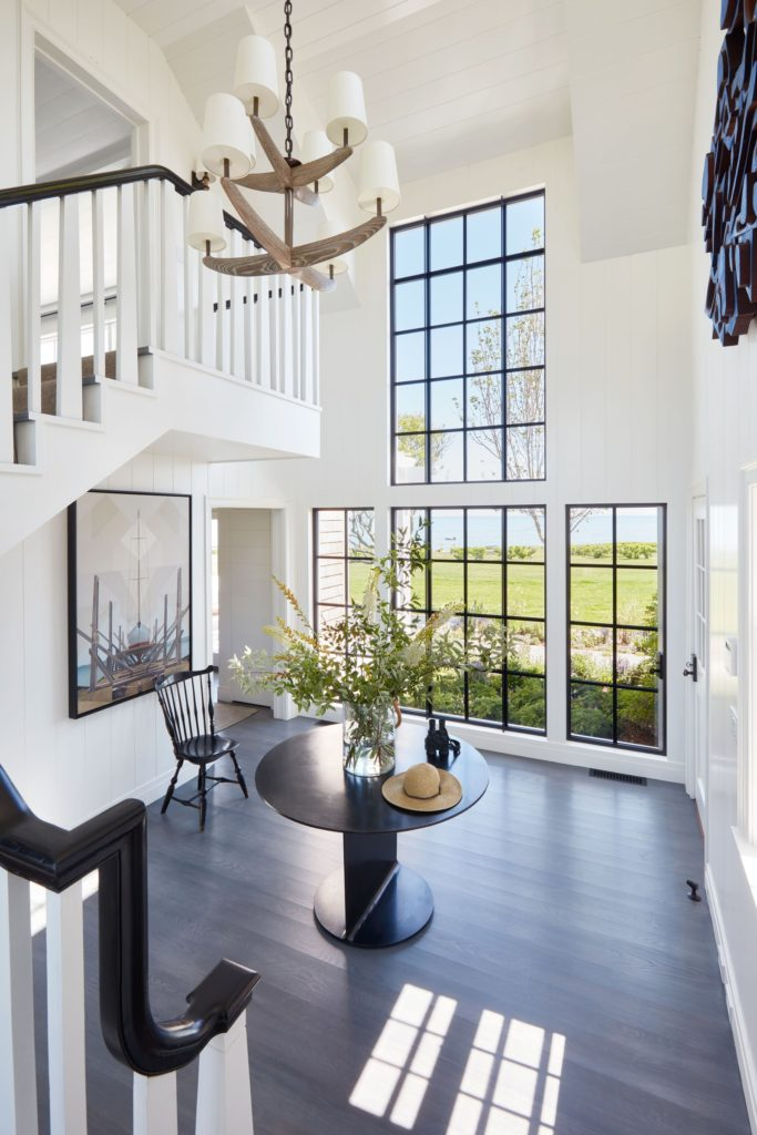 Martha's Vineyard cottage decorated by Victoria Hagan. Sunny double height foyer.