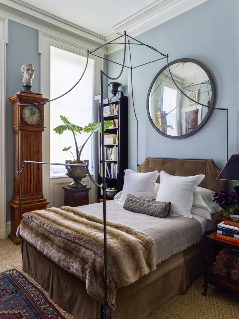 Gil Schafer New York apartment bedroom blue walls iron canopy bed sisal rug