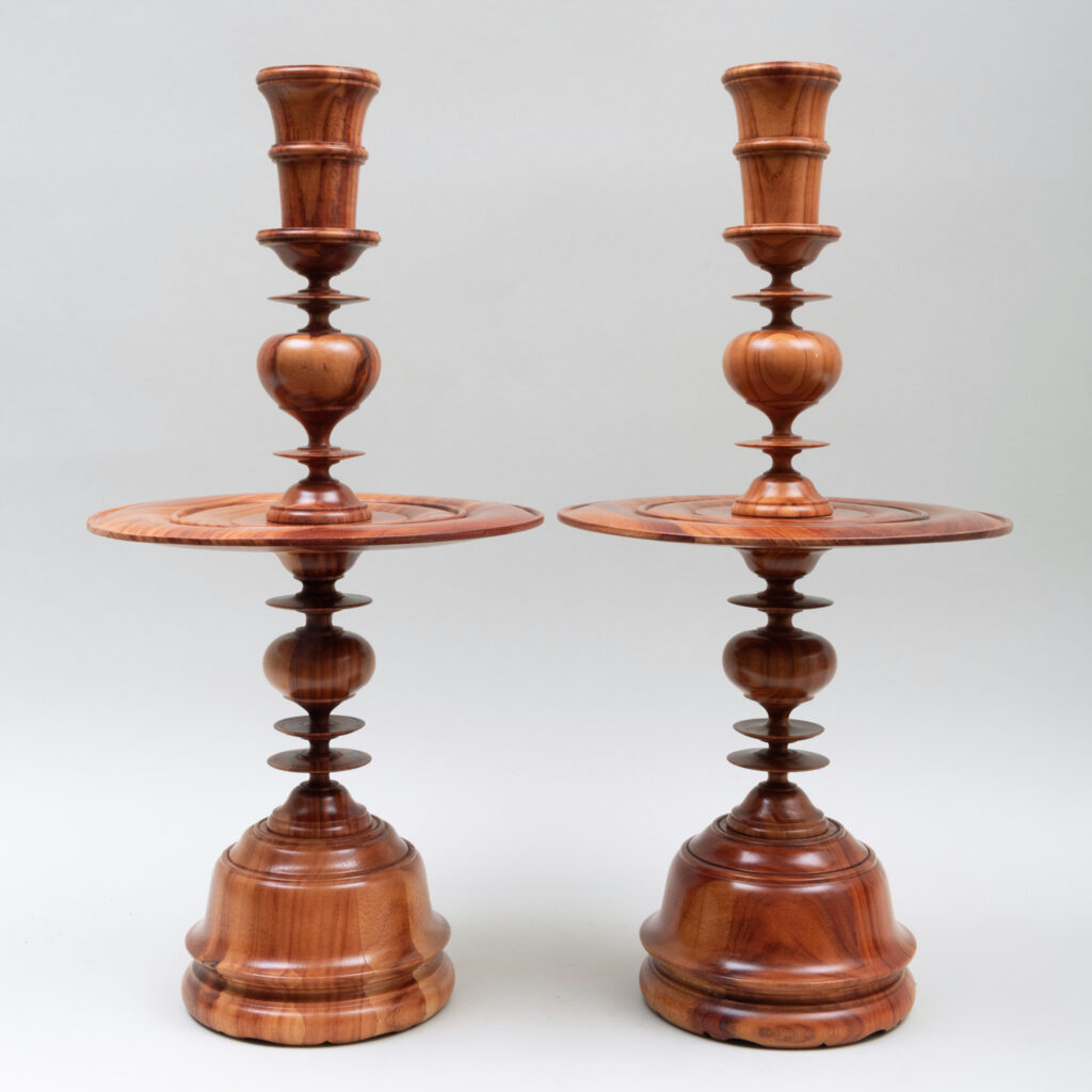 Pair of wood candlesticks from the from the John Rosselli auction at Stair Galleries