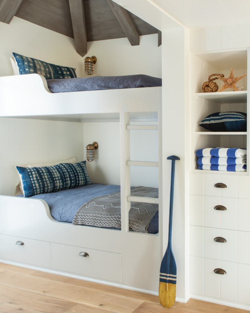 Custom built-in bunk beds in a coastal nautical style